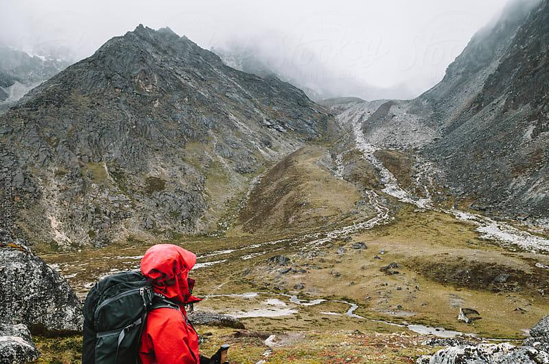 Female trekker looking back up to Kongma La Pass, Everest Region, Sagarmatha National Park, Nepal. by Thomas Pickard Photography Ltd. for Stocksy United