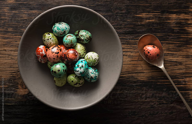 Colored Quail Eggs For Easter on Rustic Table by Jeff Wasserman for Stocksy United
