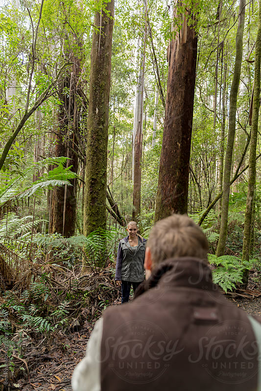 Young couple taking photographs on a bush walk by Ben Ryan for Stocksy United