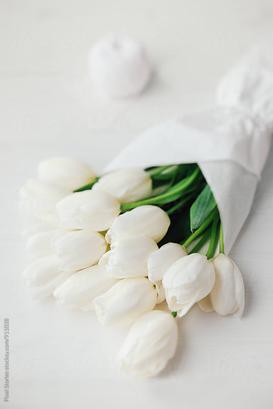 White tulips bouquet by Pixel Stories for Stocksy United