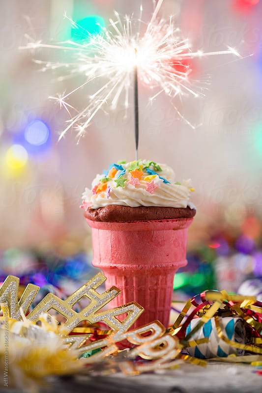 Happy New Year:  Ice Cream Cone Cupcake with Sparkler by Jeff Wasserman for Stocksy United