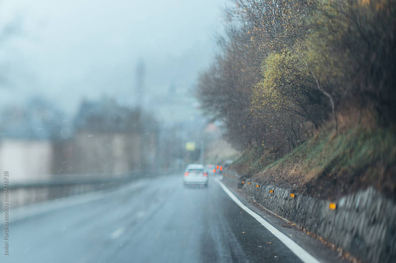driving with snow on the road by Javier Pardina for Stocksy United