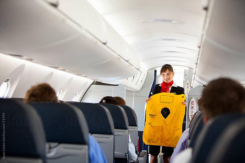 Airplane: Stewardess Hold Floatation Vest by Sean Locke for Stocksy United