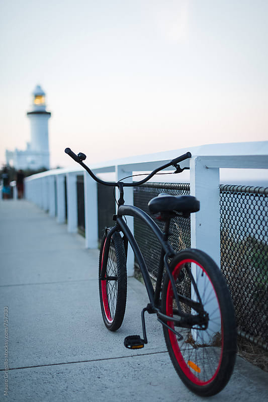 A ride by bike to the lighthouse by Mauro Grigollo for Stocksy United
