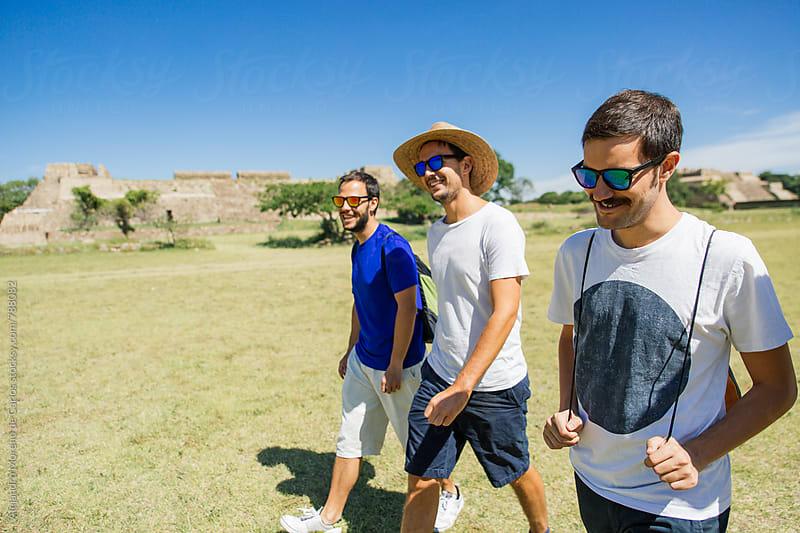 Three young men travelers walking through ancient ruins landmark in Mexico by Alejandro Moreno de Carlos for Stocksy United