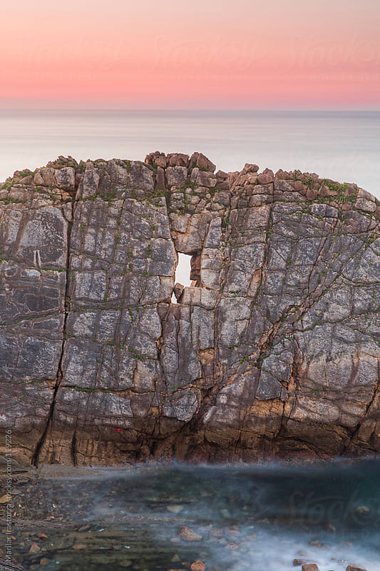 A window on a seastack on the coast of Cantabria in northern Spain by Marilar Irastorza for Stocksy United
