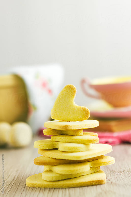 Stacked heart shape cookies, vertical by Kirsty Begg for Stocksy United