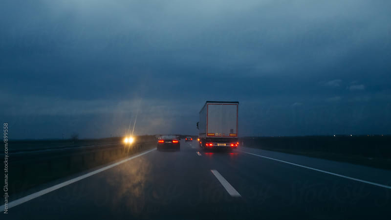 Truck and Cars in Distance on a Highway by Nemanja Glumac for Stocksy United