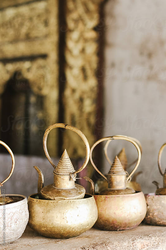 tea pots at Burma temple by Cameron Zegers for Stocksy United