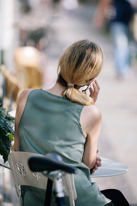 Woman using talking on Cell Phone by VegterFoto for Stocksy United