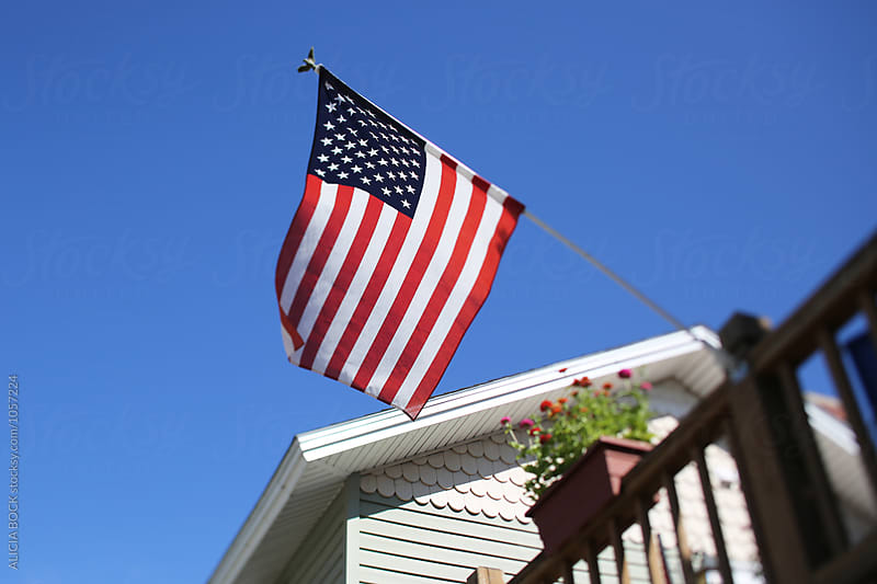 The American Flag In Front Of A Home by ALICIA BOCK for Stocksy United