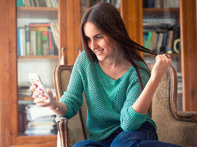 Young woman texting by Carlo Amoruso for Stocksy United