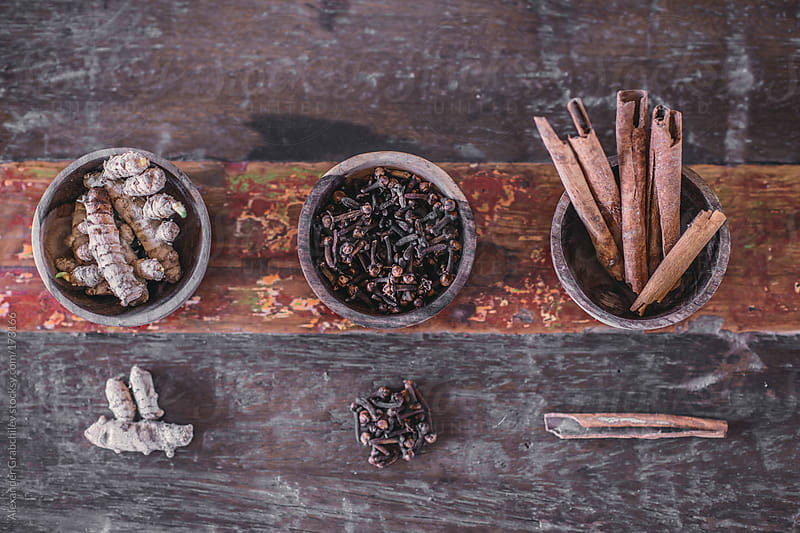 Assortment of dried spices - Ginger, Clove, Cinnamon,   by Alexander Grabchilev for Stocksy United