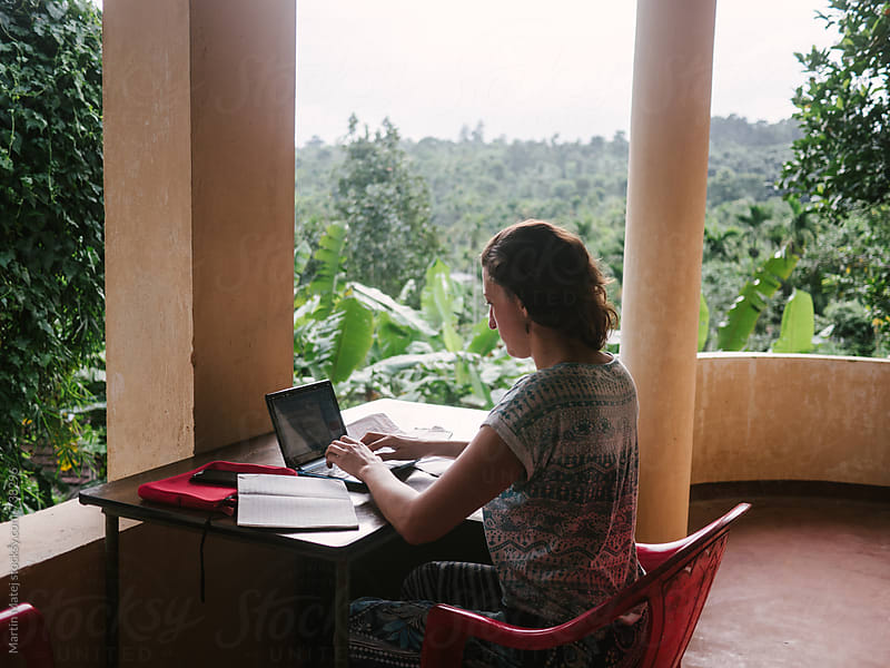 Girl who Works from anywhere, like in jungle by Martin Matej for Stocksy United