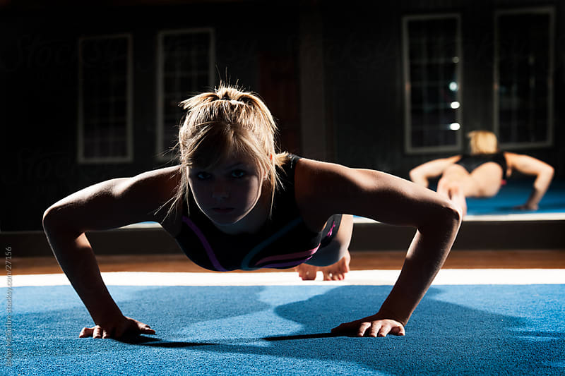 Female Gymnast Doing Push-up (Silhouette)  by Brian McEntire for Stocksy United