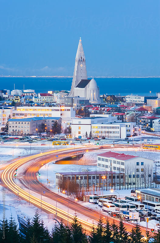 Iceland, Reykjavik, Elevated view of the city at dust by Gavin Hellier for Stocksy United