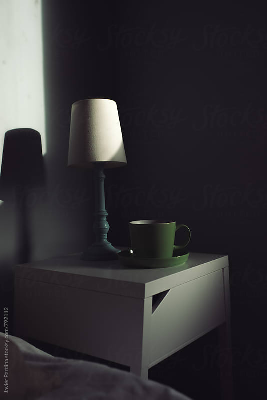 A cup and a lamp on a table in the morning by Javier Pardina for Stocksy United