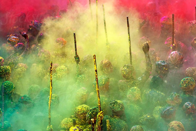 Holi Festival with colored powder spread in air by PARTHA PAL for Stocksy United