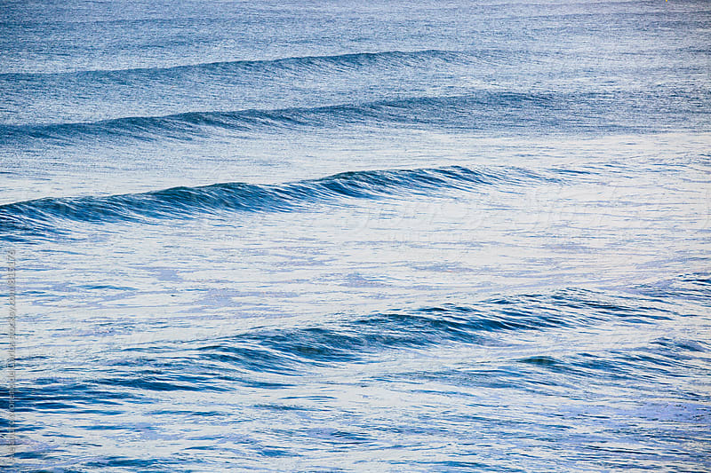 Small waves in the blue ocean sea by Alejandro Moreno de Carlos for Stocksy United