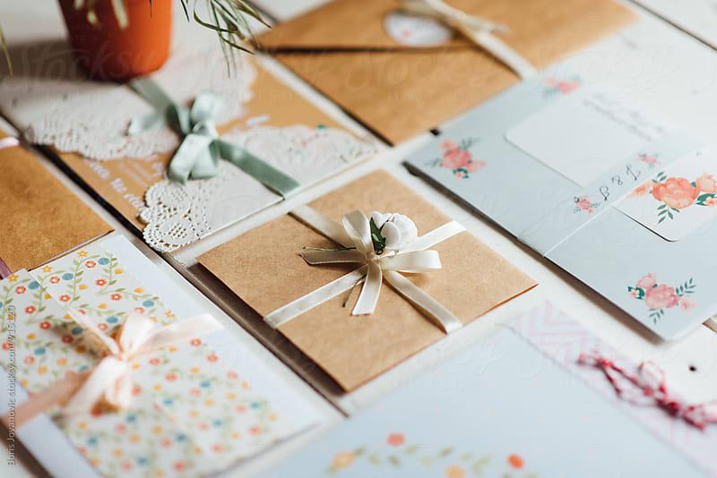 Carefully crafted wedding invitation cards by Boris Jovanovic for Stocksy United