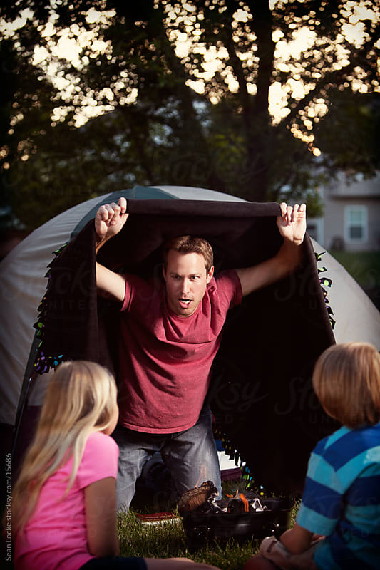Camping: Monster Dad Tells Scary Story by Sean Locke for Stocksy United
