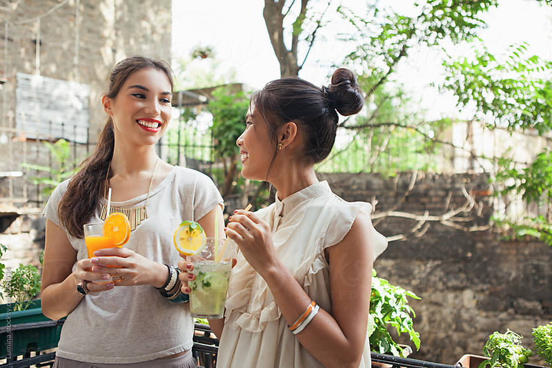 Women Drinking Juice in an Outdoor Cafe by Lumina for Stocksy United
