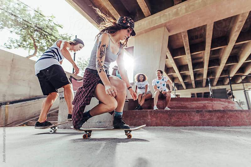 Teenagers practicing skateboarding at skate park by Jacob Ammentorp Lund for Stocksy United