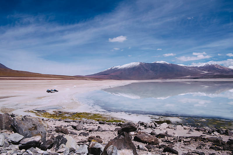 4x4s by a large salt lake in the Bolivian altiplano by Adrian Seah for Stocksy United