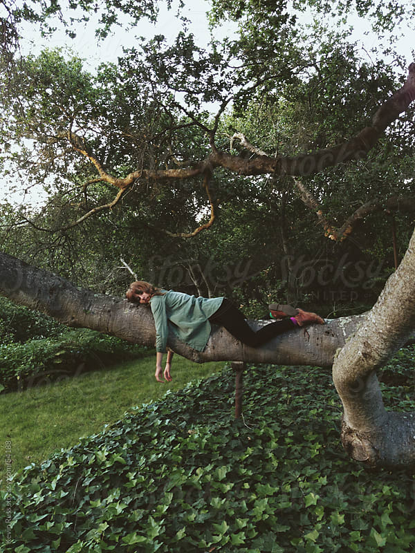 Tree Napping Woman by Kevin Russ for Stocksy United