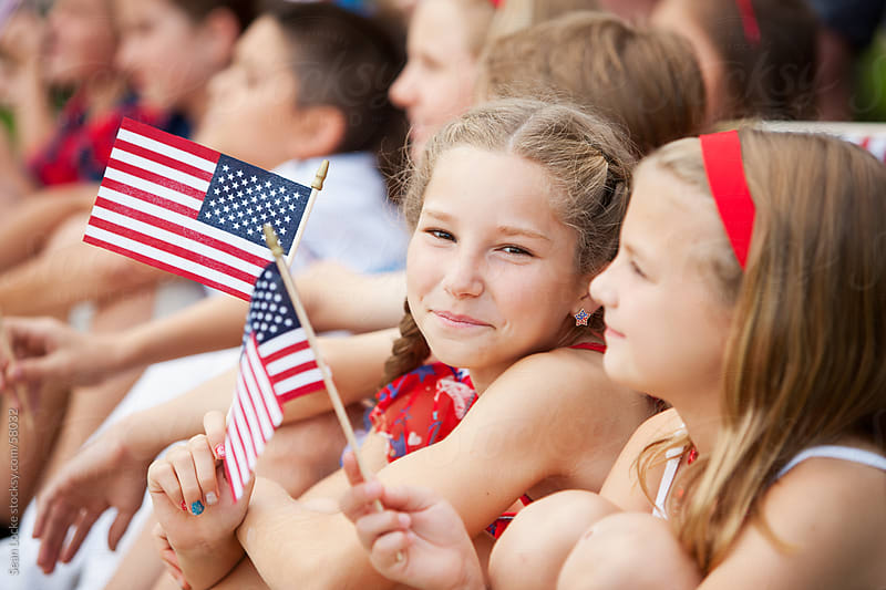 Parade: Cute Girl Holding American Flag by Sean Locke for Stocksy United
