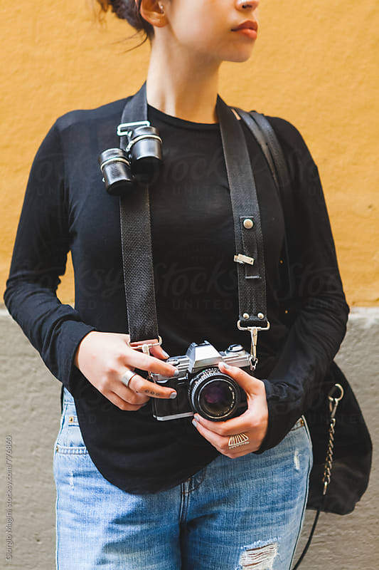 Portrait of a Young Pretty Photographer with Analog Camera and Film Holders by Giorgio Magini for Stocksy United