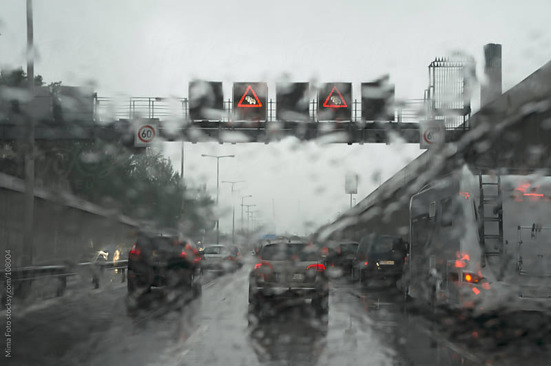Traffic jam in the rain on German Autobahn by Mima Foto for Stocksy United