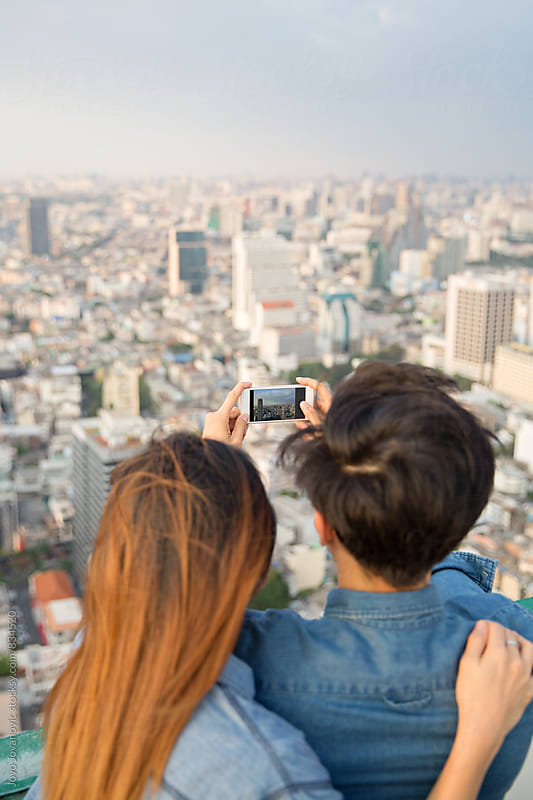 Man taking a photo of the city view by Jovo Jovanovic for Stocksy United