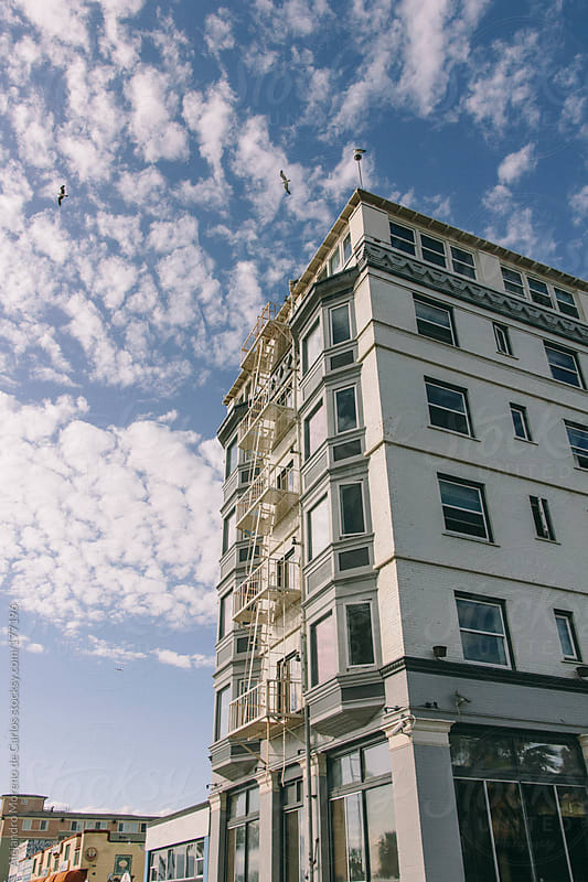Building and sky with cirrocumulus clouds by Alejandro Moreno de Carlos for Stocksy United