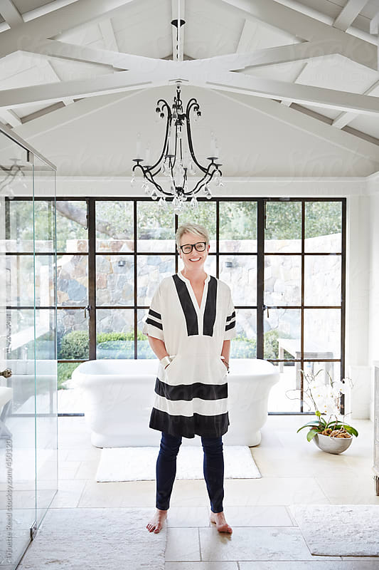 Portrait of stylish mature woman in luxury bathroom of her home by Trinette Reed for Stocksy United