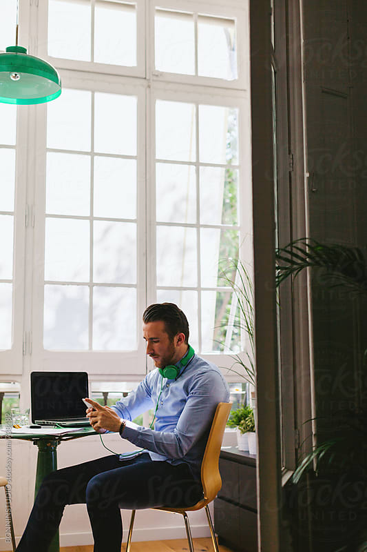 Entrepreneur man working at his modern office. by BONNINSTUDIO for Stocksy United