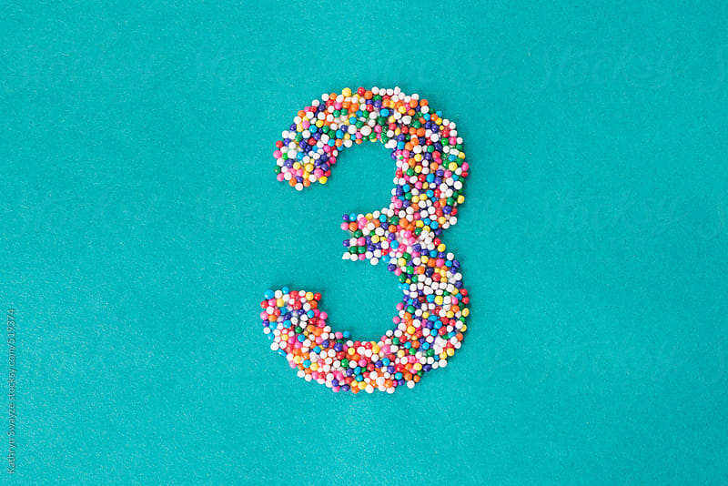 The number three built from nonpareils by Kathryn Swayze for Stocksy United