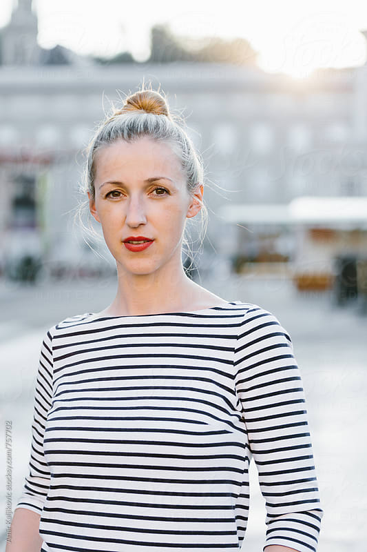 Woman in Striped Shirt Standing in City Square by Amir Kaljikovic for Stocksy United