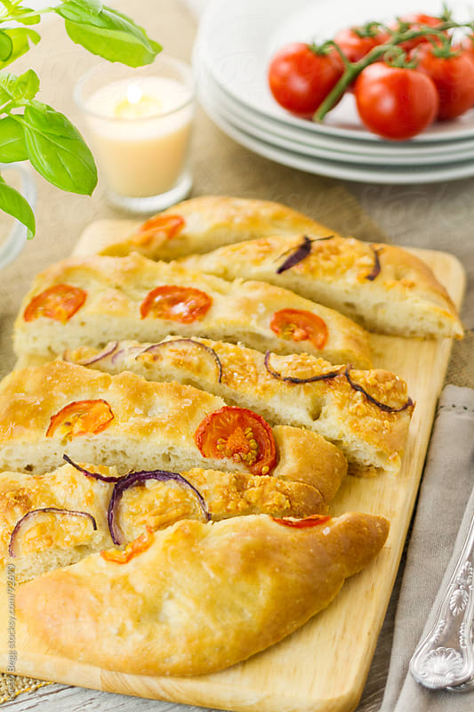 Mixed focaccia slices vertical by Kirsty Begg for Stocksy United