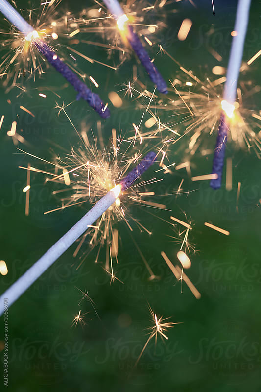 Close Up Of Four Lit Fourth Of July Sparklers by ALICIA BOCK for Stocksy United