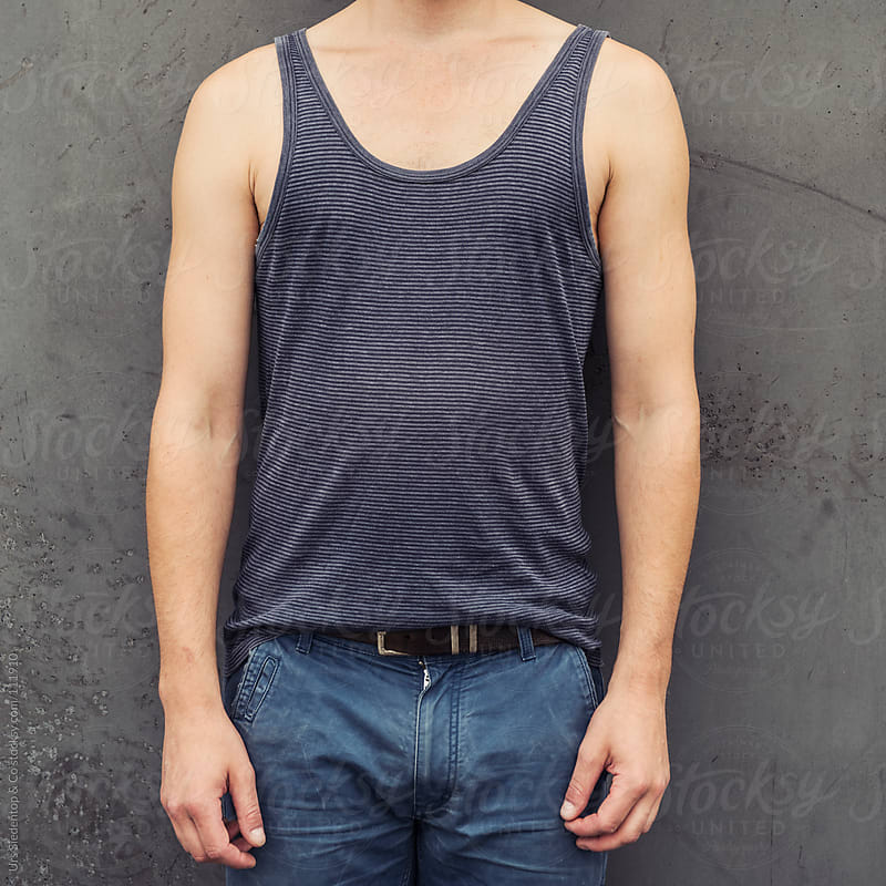 Man in tank top by Urs Siedentop & Co for Stocksy United