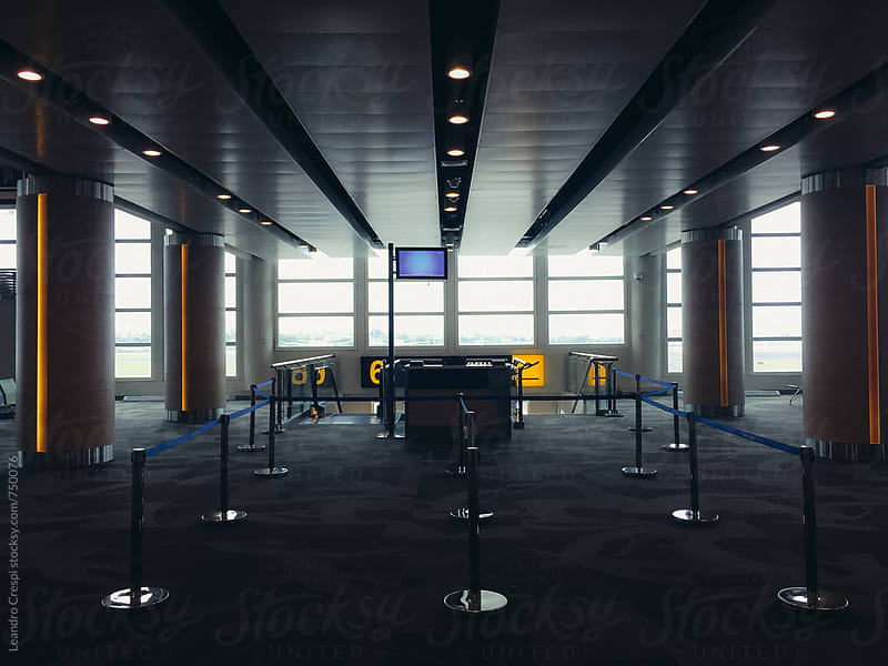 An airport boarding gate  by Leandro Crespi for Stocksy United