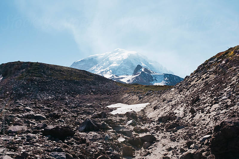 water evaporating from top of mt. rainier in washington by Jesse Morrow for Stocksy United