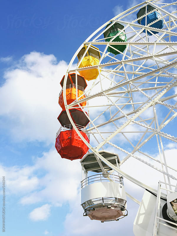 Colourful cabins on a ferris wheel on an amusement park. by BONNINSTUDIO for Stocksy United