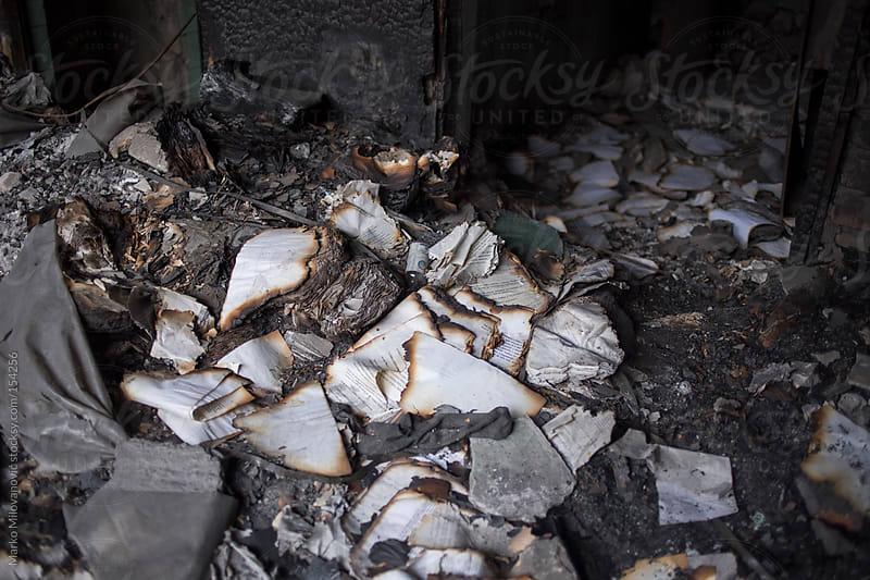 Burnt books, paper by Marko Milovanović for Stocksy United