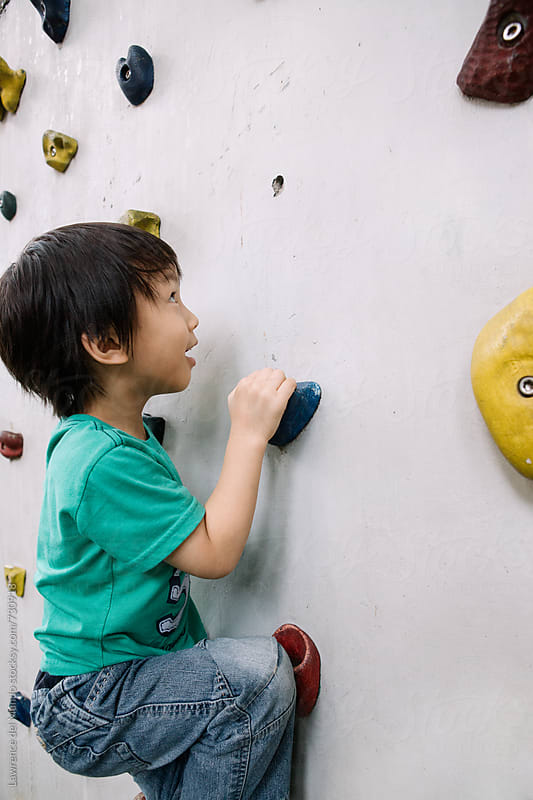 A very young rock climber in training by Lawrence del Mundo for Stocksy United