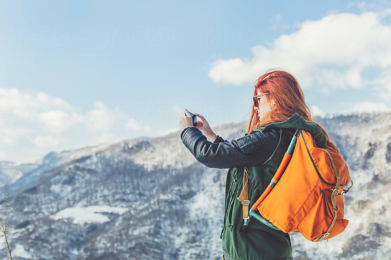 Woman Photographing a Landscape With Her Mobile Phone by Lumina for Stocksy United