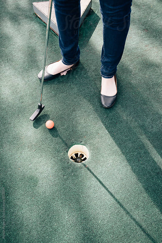 Feet and Club Standing Near Putt Putt Hole by Austin Rogers for Stocksy United