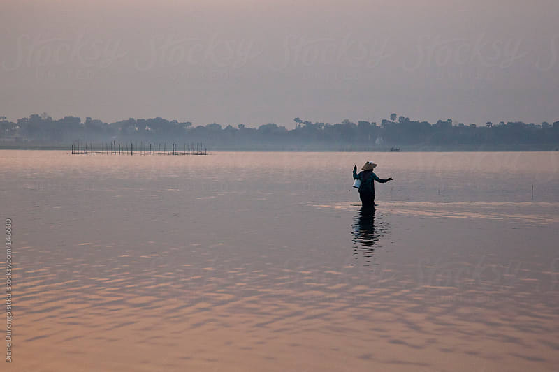 Early Morning Fisherman by Diane Durongpisitkul for Stocksy United