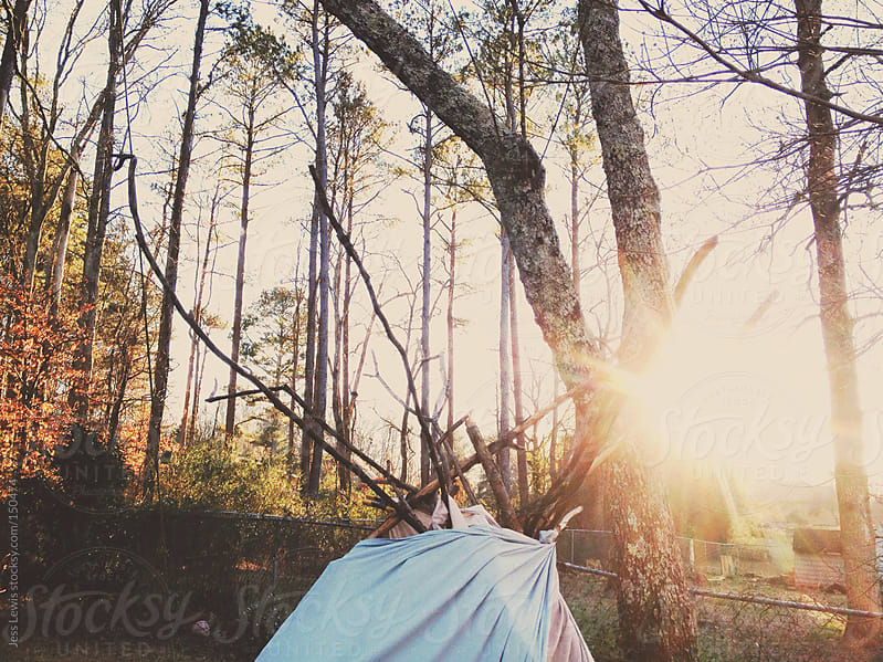 homemade tent in sunlight by Jess Lewis for Stocksy United